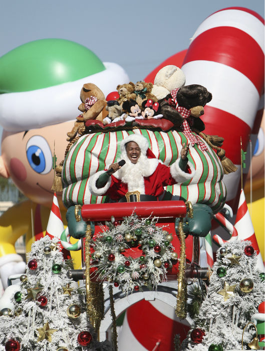 Nick Cannon is joined by Disney Channel characters Phineas and Ferb during the taping of the 2011 Disney Parks Christmas Day Parade at Disneyland in Anaheim, California, on Nov. 5, 2011. The show airs Christmas Day, at various times across the country, on