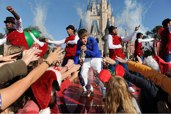 Justin Bieber appears at the 2011 Disney Parks Christmas Day Parade at Walt Disney World's Magic Kingdom in Florida. The special airs Christmas Day, at various times across the country, on ABC.