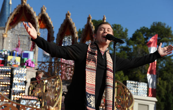 "<div class=""meta ""><span class=""caption-text "">'American Idol' season 10 winner Scotty McCreery appears at the 2011 Disney Parks Christmas Day Parade at Walt Disney World's Magic Kingdom in Florida. The special airs Christmas Day, at various times across the country, on ABC.  (Disney / Mark Ashman)</span></div>"