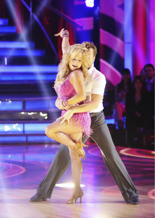 Sabrina Bryan and Louis Van Amstel appear in a sti