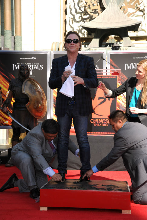 "<div class=""meta ""><span class=""caption-text "">Actor Mickey Rourke is immortalized at his Hand and Footprint Ceremony held at Grauman's Chinese Theatre on Oct. 31, 2011 in Hollywood, California.   (Getty Images / Royalty-free / Frazer Harrison)</span></div>"