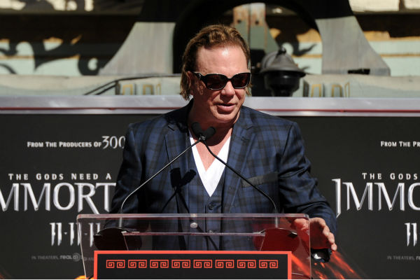 Actor Mickey Rourke is immortalized at his Hand and Footprint Ceremony held at Grauman&#39;s Chinese Theatre on Oct. 31, 2011 in Hollywood, California.   <span class=meta>(Getty Images &#47; Royalty-free &#47; Frazer Harrison)</span>