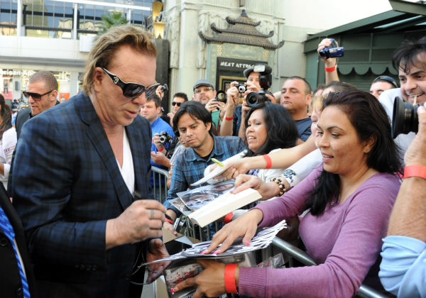 Actor Mickey Rourke signs autographs at his Hand and Footprint Ceremony held at Grauman's Chinese Theatre on Oct. 31, 2011 in Hollywood, California.