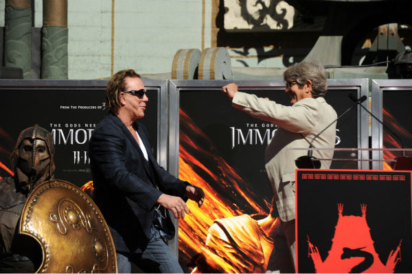 Actors Mickey Rourke and Eric Roberts onstage at Mickey Rourke&#39;s Hand and Footprint Ceremony held at Grauman&#39;s Chinese Theatre on Oct. 31, 2011 in Hollywood, California.  <span class=meta>(Getty Images &#47; Royalty-free &#47; Frazer Harrison)</span>