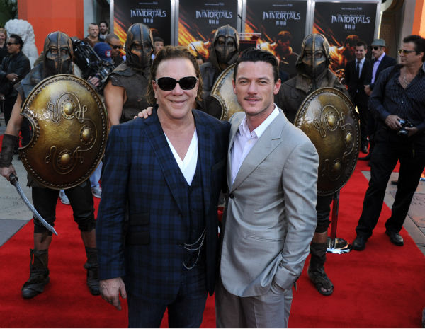 "<div class=""meta image-caption""><div class=""origin-logo origin-image ""><span></span></div><span class=""caption-text"">Actors Mickey Rourke and Luke Evans attend Mickey Rourke's Hand and Footprint Ceremony held at Grauman's Chinese Theatre on Oct. 31, 2011 in Hollywood, California.   (Getty Images / Royalty-free / Frazer Harrison)</span></div>"