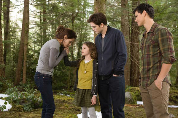 Kristen Stewart, Mackenzie Foy, Robert Pattinson and Taylor Lautner appear in a scene from the 2012 movie 'Twilight: Breaking Dawn - Part 2.'