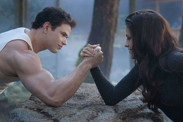 Kellan Lutz and Kristen Stewart appear in a...