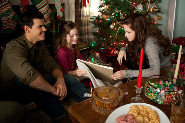 Taylor Lautner, Mackenzie Foy and Kristen Stewart appear in a scene from the 2012 movie 'Twilight: Breaking Dawn - Part 2,' which opens in thea