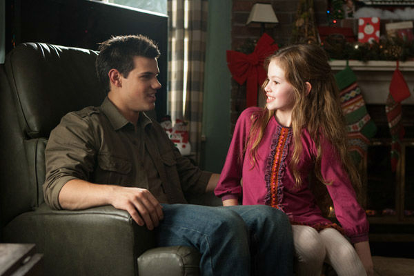 Taylor Lautner and Mackenzie Foy appear in a scene from the 2012 movie 'Twilight: Breaking Dawn - Part 2,' which opens in theaters on N