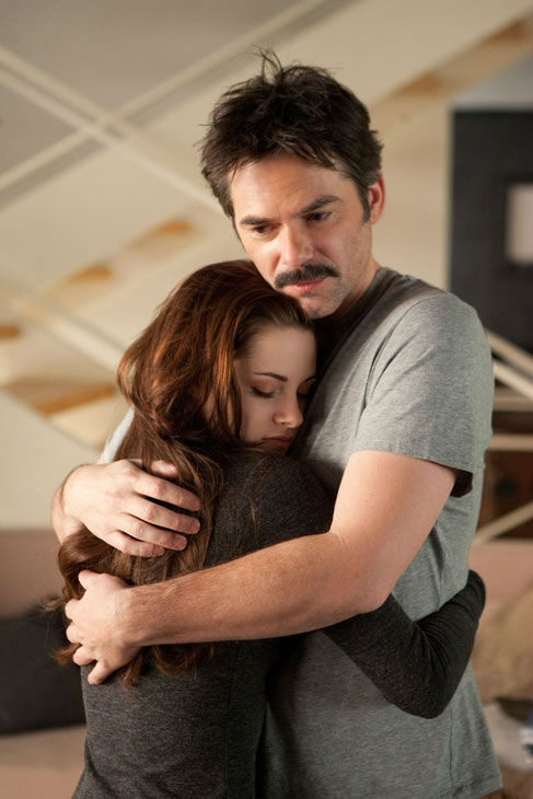 Kristen Stewart and Billy Burke appear in a scene from the 2012 mo