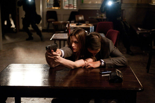 Anne Hathaway appears as Selina Kyle aka Catwoman and Burn Gorman as Stryver in 'The Dark Knight Rises,' set to hit theaters on July 20, 2012.