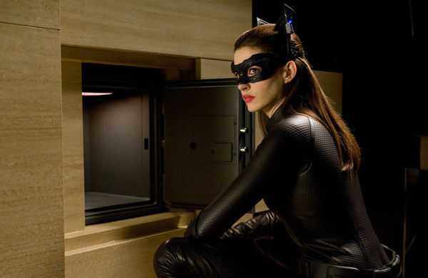 Anne Hathaway appears as Selina Kyle aka...