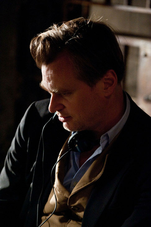 "<div class=""meta image-caption""><div class=""origin-logo origin-image ""><span></span></div><span class=""caption-text"">Director Christopher Nolan appears on the set of 'The Dark Knight Rises,' set to hit theaters on July 20, 2012. (Warner Bros. Pictures/Ron Phillips)</span></div>"