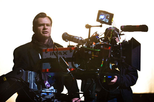 Director Christopher Nolan appears on the set of...