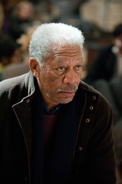 Morgan Freeman appears as Lucius Fox in 'The...