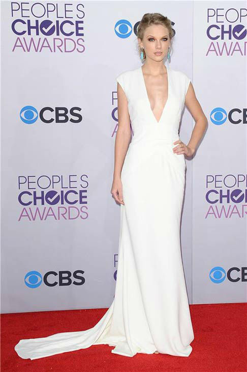 Taylor Swift wore a v-neck floor-length white dress complete with turquoise earrings and severe smokey-eye makeup at the 2013 People's Choice Awards in Los Angeles, California on Jan. 9, 2013.