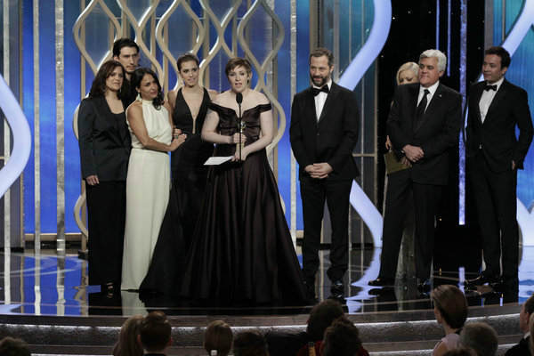 Lena Dunham (center), Winner, Best TV Series, Comedy or Musical on stage during the 70th Annual Golden Globe Awards held at the Beverly Hilton Hotel on January 13, 2013.