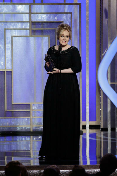 "<div class=""meta image-caption""><div class=""origin-logo origin-image ""><span></span></div><span class=""caption-text"">Adele gives a sweet and snarky speech for her 'Skyfall' win  New mom Adele nabbed the Golden Globe award for Best Original Song - Motion Picture for 'Skyfall,' the title theme from the James Bond film of the same name. After getting a high-five from Daniel Craig, Adele got up and delivered a sweet and a little bit snarky speech.   'Oh my god,' the singer said repeatedly. 'Honestly I've come out for a night out with my friend Ida. We're new mums. We've literally come for a night out. I was not expecting this. Thank you so much!'  'I'd like to thank the Hollywood Foreign Press ... I'd never thought I'd say that,' she quipped.   (Pictured: Winner Adele, Best Original Song - Motion Picture, 'Skyfall' on stage during the 70th Annual Golden Globe Awards held at the Beverly Hilton Hotel on January 13, 2013.) (Paul Drinkwater/NBC)</span></div>"