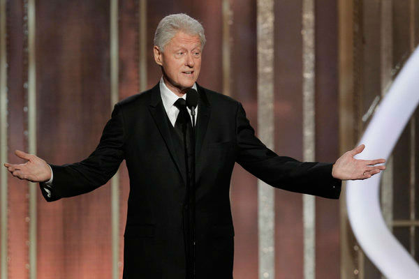 Presenter Bill Clinton on stage during the 70th Annual Golden Globe Awar