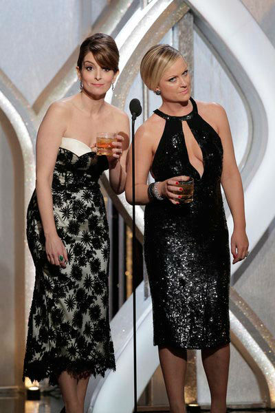 Hosts Tina Fey, Amy Poehler on stage during the...