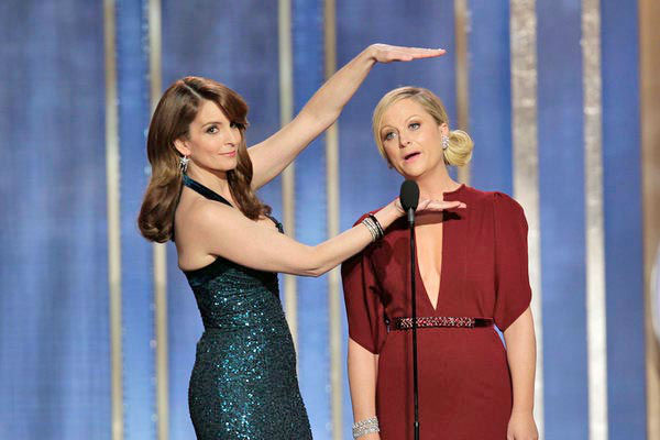 Tina Fey, Amy Poehler on stage during the 70th Annual Golden Globe Awards held at the Beverly Hilton Hotel on January 13, 2013.   During their opening monologue for the show, the two dished out jokes about Ricky Gervais, James Cameron and the Hollywood Foreign Press Association. They claimed that Daniel Day-Lewis played E.T. once and referenced Kathryn Bigelow&#39;s nomination for Best Director - Motion Picture for &#39;Zero Dark Thirty&#39; and her previous marriage to &#34;Avatar&#34; and &#34;Titanic&#34; director James Cameron.   &#39;I haven&#39;t really been following the controversy over &#39;Zero Dark Thirty&#39; but when it comes to torture, I trust the lady who spent three years married to James Cameron,&#39; Poehler said, drawing thundering laughter and &#39;oooohs&#39; from the audience. <span class=meta>(Paul Drinkwater&#47;NBC)</span>