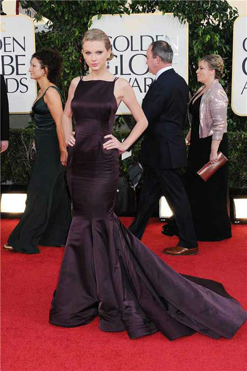 Taylor Swift arrived in a dramatic plum floor-length gown by Donna Karen Atelier to the 70th annual Golden Globe Awards at the Beverly Hilton Hotel in Los Angeles, California on Jan. 13, 2013.