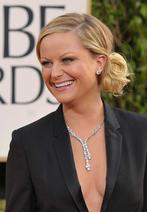 Amy Poehler arrives at the 70th Annual Golden Globe Awards at the Beverly Hilton Hotel on Su