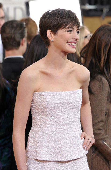 Actress Anne Hathaway arrives at the 70th Annual Golden Globe Awards at the Beverly Hilton Hotel on Sunday Jan. 13, 2013, in Beverly Hills, Calif.