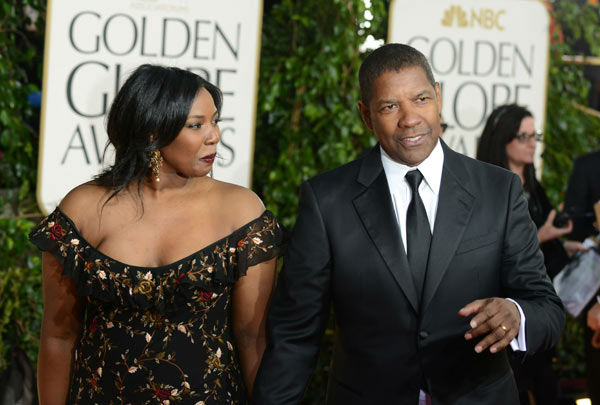 Actor Denzel Washington, right, and Pauletta Pearson Washington arrive at the 70th Annual Golden Globe Awards at the Beverly Hilton Hotel on Sunday Jan. 13