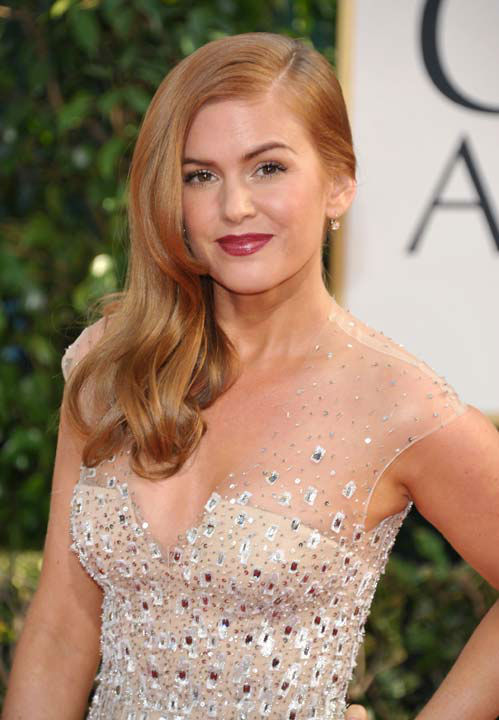 Isla Fisher arrives at the 70th Annual Golden Globe Awards at the Beverly Hilton Hotel on Sunday Jan. 13, 2013, in Beverly Hills, Calif.