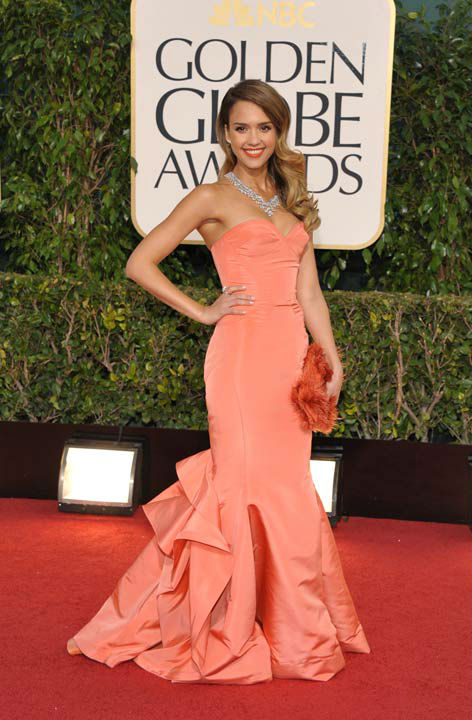 Actress Jessica Alba arrives at the 70th Annual Golden Globe Awards at the Beverly Hilton Hotel on Sunday Jan. 13, 2013, in Beverly Hills, Calif.