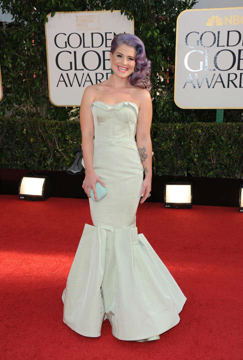 TV personality Kelly Osbourne arrives at the 70th Annual Golden Globe Awards at the Beverly Hilton Hotel on Sunday Jan. 13, 2013, in Beverly Hills, Calif.