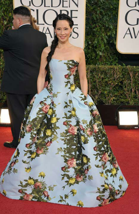 Actress Lucy Liu arrives at the 70th Annual Golden Globe Awards at the Beverly Hilton Hotel on Sunday Jan. 13, 2013, in Beverly Hills,