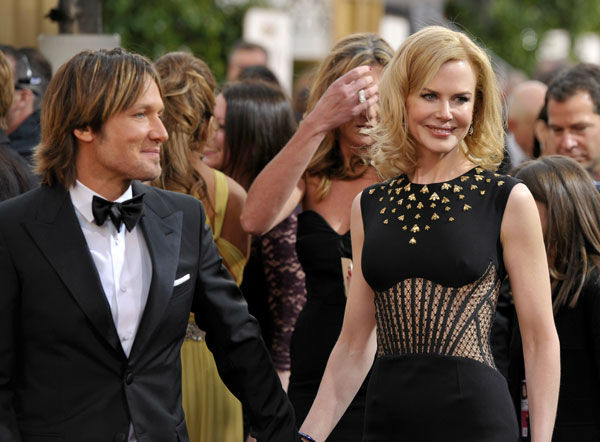 Musician Keith Urban, left, and actress Nicole Kidman arrive at the 70th Annual Golden Globe Awards at the Beverly Hilto