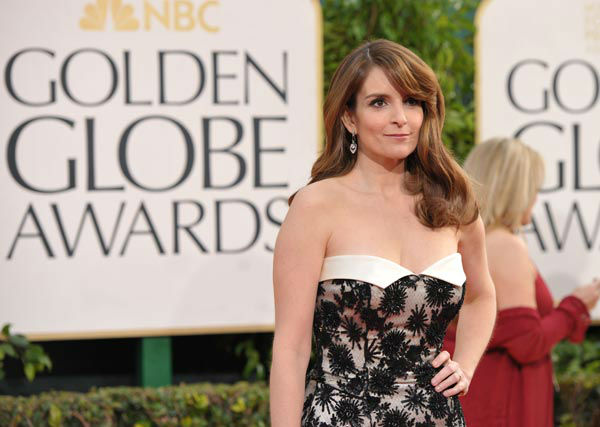 Actress Tina Fey arrives at the 70th Annual Golden Globe Awards at the Beverly Hilton Hotel on Sunday Jan. 13, 2013, in Beverly Hills, Calif.