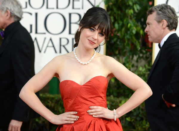 "<div class=""meta ""><span class=""caption-text "">Actress Zooey Deschanel arrives at the 70th Annual Golden Globe Awards at the Beverly Hilton Hotel on Sunday Jan. 13, 2013, in Beverly Hills, Calif.  (Photo/Jordan Strauss)</span></div>"