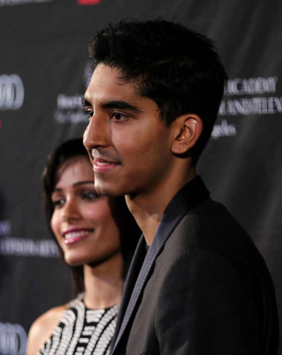 Actors Dev Patel, right, and Freida Pinto arrive...