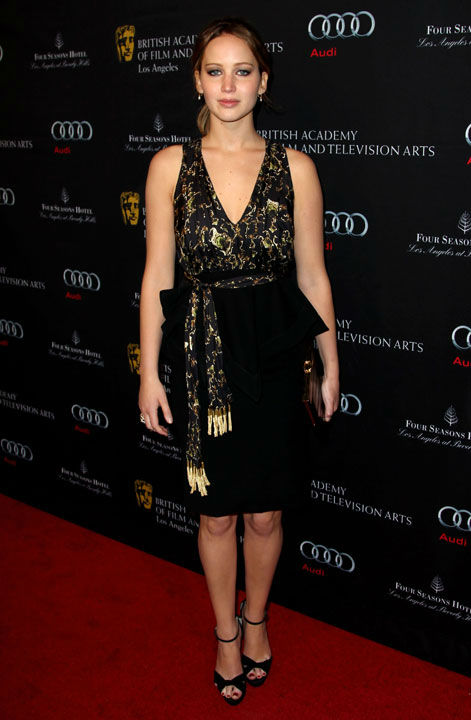 "<div class=""meta ""><span class=""caption-text "">Oscar nominee Jennifer Lawrence arrives at the BAFTA Awards Season Tea Party at The Four Seasons Hotel on Saturday, Jan. 12, 2013, in Los Angeles. The actress dazzled in a black and gold Altuzarra dress which she paired with black, strappy sandals for the celebration. (Photo/Matt Sayles)</span></div>"