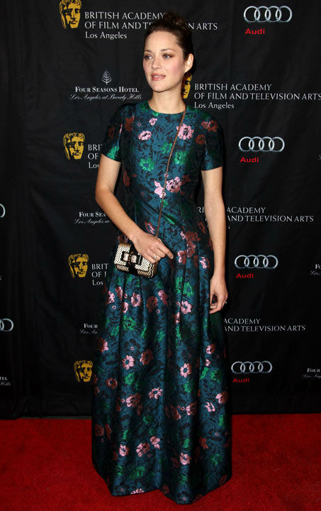 "<div class=""meta image-caption""><div class=""origin-logo origin-image ""><span></span></div><span class=""caption-text"">Marion Cotillard arrives at the BAFTA Awards Season Tea Party at The Four Seasons Hotel on Saturday, Jan. 12, 2013, in Los Angeles.  (Photo/Matt Sayles)</span></div>"