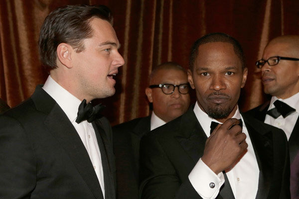 Actors Leonardo DiCaprio and Jamie Foxx attend...