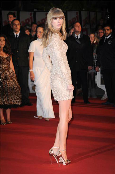Taylor Swift wore a nude long-sleeved v-neck mini dress from Eli Saab&#39;s Spring 2013 collection on the red carpet at the 2013 NRJ Music Awards in Cannes, France on Jan. 26, 2013. <span class=meta>(Nicolas Gouhier &#47; startraksphoto.com)</span>
