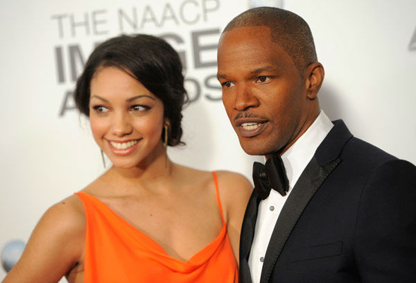 Jamie Foxx and guest arrive at the 44th Annual NAACP Image Awards at the Shrine Auditorium in Los Angeles on Friday, Feb. 1, 2013.