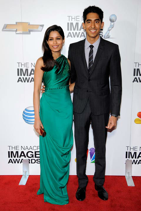 Freida Pinto, left, and Dev Patel arrive at the...