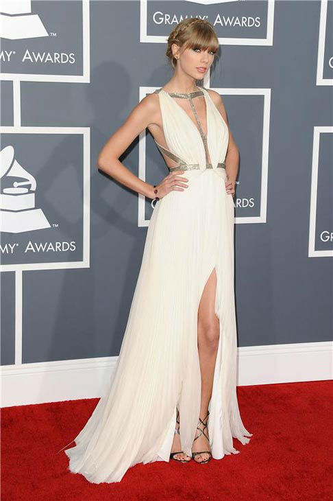 Taylor Swift channeled a sexy Greek goddess in a white and metallic-accented J. Mendel pleated gown complete with a thigh-high slit and milkmaid braid at the 55th annual GRAMMY Awards in Los Angeles, California on Feb. 10, 2013.