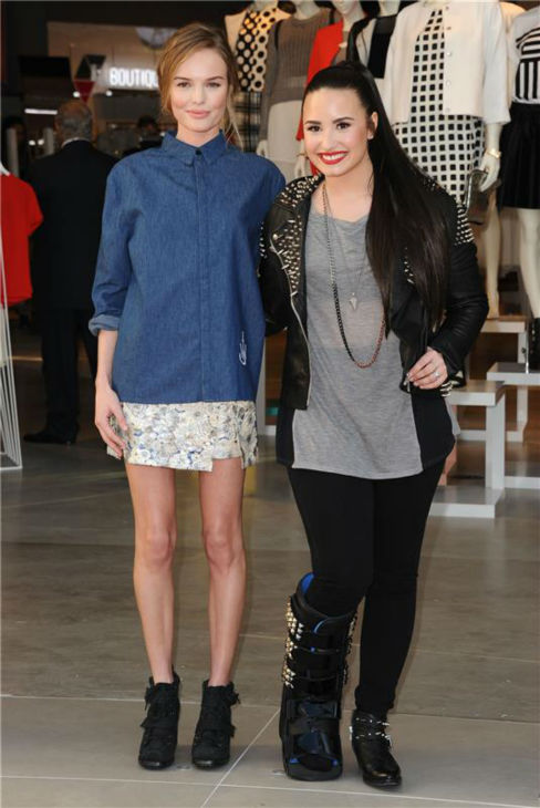 Demi Lovato poses with actress Kate Bosworth at the opening of a Topshop Topman store in Los Angeles on Feb. 14, 2012. <span class=meta>(Sara De Boer &#47; startraksphoto.com)</span>