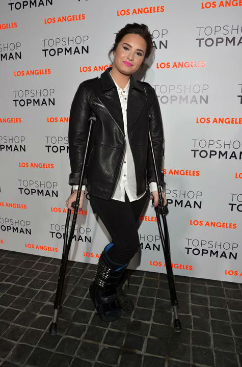 "<div class=""meta image-caption""><div class=""origin-logo origin-image ""><span></span></div><span class=""caption-text"">Actress/singer Demi Lovato arrives wearing Topshop at the Topshop Topman LA Opening Party at Cecconi's West Hollywood on February 13, 2013 in Los Angeles, California. (Getty Images for Topshop /Lester Cohen)</span></div>"