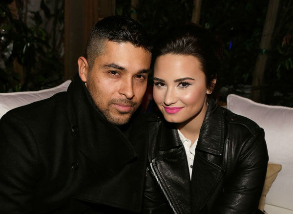 Actor Wilmer Valderrama &#40;L&#41; and singer Demi Lovato wearing Topshop attend the Topshop Topman LA Opening Party at Cecconi&#39;s West Hollywood on February 13, 2013 in Los Angeles, California.  <span class=meta>(Getty Images for Topshop &#47;Jeff Vespa)</span>
