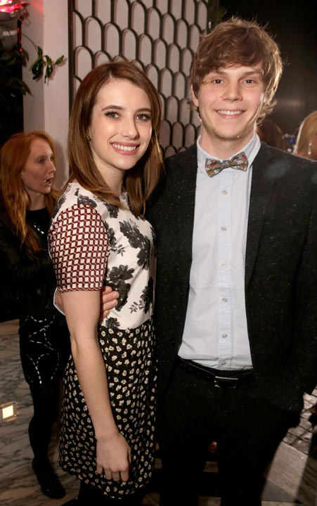 Actors Emma Roberts (L) and Evan Peters attend...