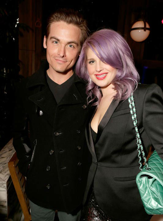 Actor Kevin Zegers and Kelly Osborne wearing...