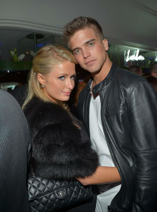 Paris Hilton (L) and River Viiperi attend the...